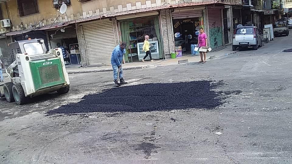 أعمال ترميم للحفر في شارع انطاكية